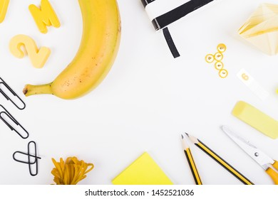 Composition of school supplies and juicy fruit
