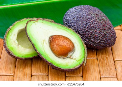 Composition of several avocados on a wood background