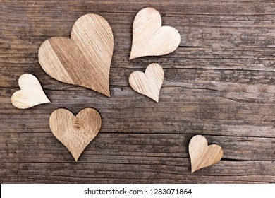 Composition of several wooden hearts on wood