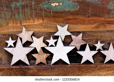 Composition of several wooden stars on a wooden table