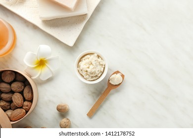 Composition with shea butter on light background