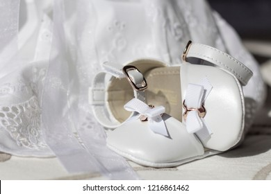 Composition of shoes and christening suit. Baptism