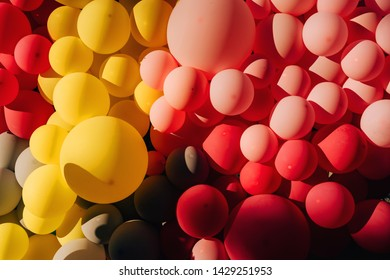 The composition of small and large balloons. The texture of the pink balls. Walk along Arbat street in the city of Shymkent. Festival of flowers in Kazakhstan.