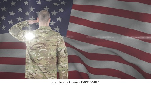 Composition of soldier saluting against american flag. united states of america patriotism and independence concept digitally generated image.