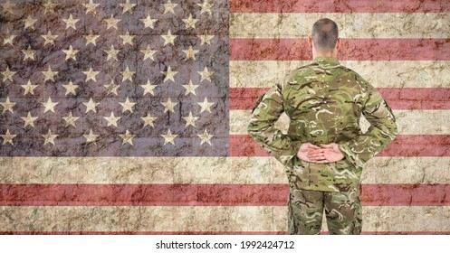 Composition of soldier standing against american flag. united states of america patriotism and independence concept digitally generated image.