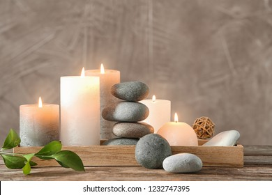 Composition with spa stones on wooden table