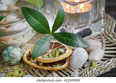 Composition of spa treatment with green salt and soap on wooden background. Spa concept.