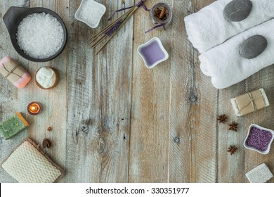 Composition of spa treatment on the wooden table. Top view