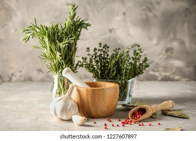 Composition with spices and herbs on table