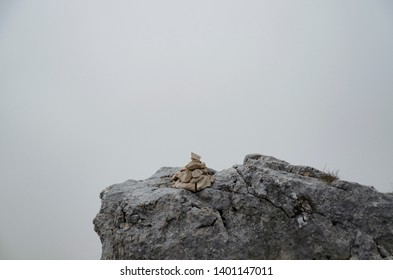 The composition of the stones composed in a pyramid. Misty morning in the mountains.