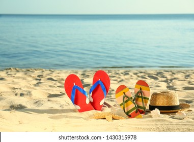 Composition with stylish beach accessories on sand near sea. Space for text