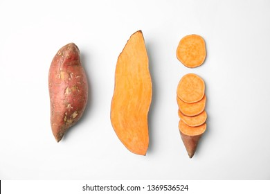 Composition with sweet potatoes on white background, top view - Shutterstock ID 1369536524