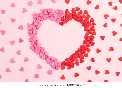 Composition of  sweets in the shape of  heart. Celebration concept for valentine's , mother's  and women's day. Colorful Valentines Day greeting cards, invitation.