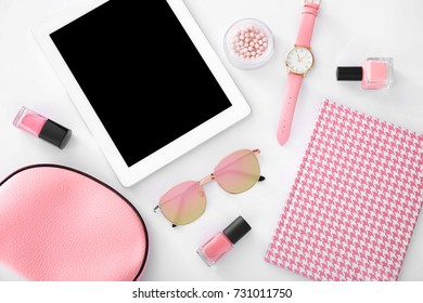 Composition with tablet, cosmetics and accessories on white background. Beauty blogger concept