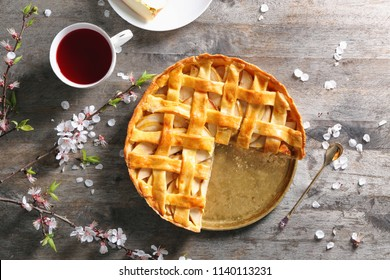 Composition with tasty apple pie on wooden table