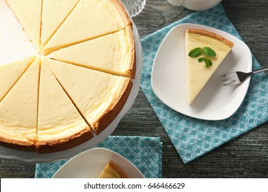 Composition with tasty cheesecake on wooden table