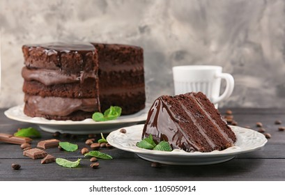 Composition with tasty chocolate cake on wooden table