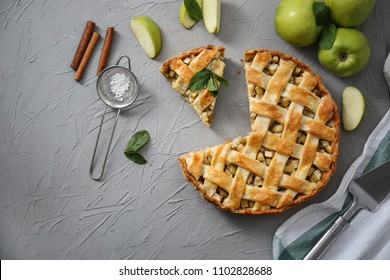 Composition with tasty homemade apple pie on table