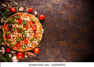Composition with tasty pizza and ingredients, space for your text, flat lay