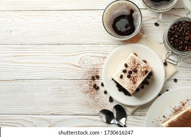 Composition with tasty tiramisu on white wooden background. Delicious dessert
