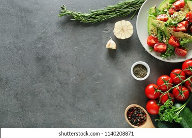 Composition with tasty vegetable salad on grey background