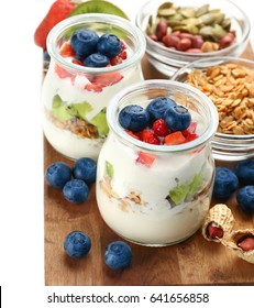 Composition with tasty yogurt on white background