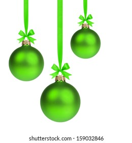 composition from three green christmas balls hanging on ribbon, white background