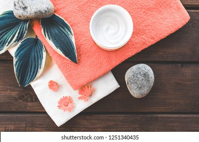 composition top view of bathroom and spa beauty room. Moisturizing and skin care, flowers, cream and natural ingredients, free place . Color of the year 2019 Living coral . COY Livingcoral.