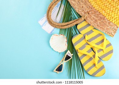 Composition with tourist's stuff on color background, top view