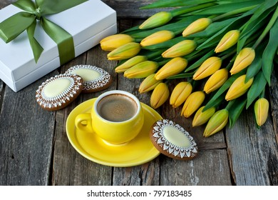 Composition with tulips,  coffee cup and tasty cookies. Easter background