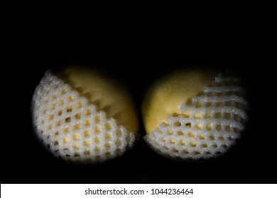 composition of two yellows pears in white openwork shell as a breast in bra. Close up