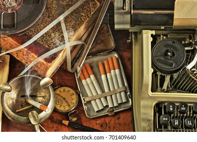 Composition with typewriter, books, cigarettes, and clocks in a retro style