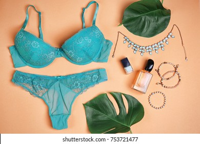 Composition with underwear and accessories on apricot background