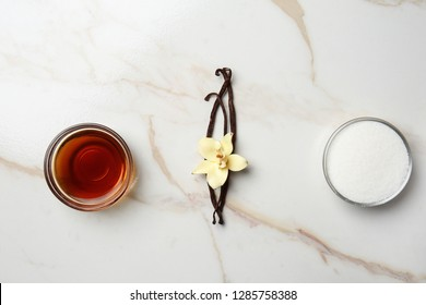 Composition with vanilla extract and sugar on table