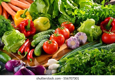 Composition with variety of fresh organic vegetables and fruits.