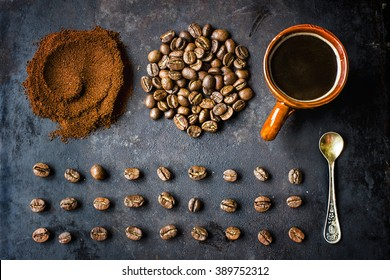 Composition of various coffee beans and coffee cups. Rustic still life. Top view