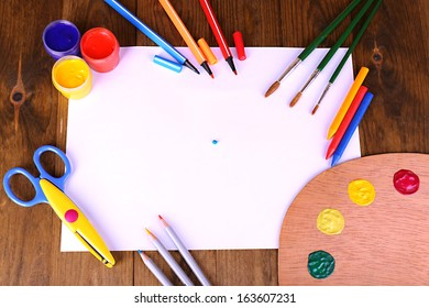 Composition of various creative tools on table close-up