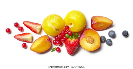 composition of various fruits and berries isolated on white background, top view