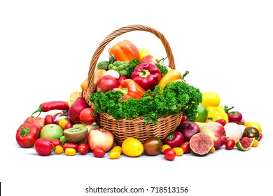 Composition with vegetables and fruits in wicker basket isolated on white. Vegetable backdrop.