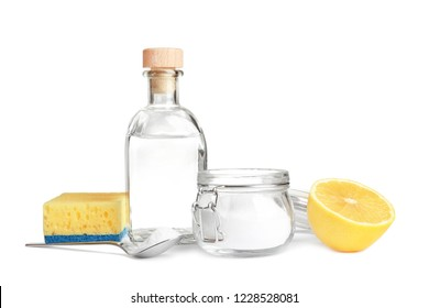 Composition with vinegar, lemon and baking soda on white background. House cleaning