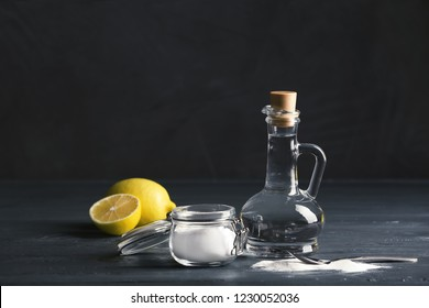 Composition with vinegar, lemons and baking soda on table