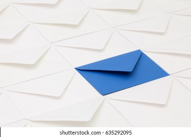 Composition with white envelopes and one dark blue  envelope on the table.