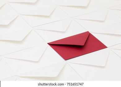 Composition with white envelopes and one dark red  envelope on the table.