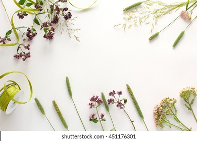 Composition of wildflowers and floral tape. Flat lay