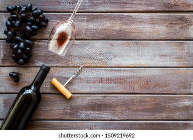 Composition with wine bottle on dark wooden background top view space for text