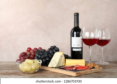 Composition with wine and snacks on table. Space for text