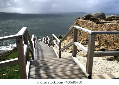composition of wooden stairs in a surreal  landscape by the ocean, psychological photography, abstract surrealism, symmetry, symmetrical, natural, patterns, water, dew,nature,composition