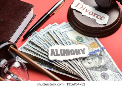 Composition with words ALIMONY and DIVORCE with money on color background