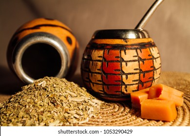 composition Yerba mate-South American tea, dried leaves in wooden bowl with a wooden mate calabash with tea