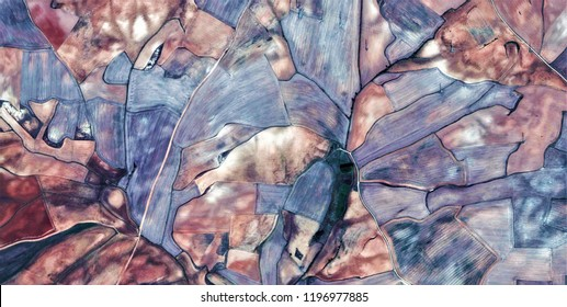 composition,tribute to Picasso, abstract photography of the Spain fields from the air, aerial view, representation of human labor camps, abstract, cubism, abstract naturalism,